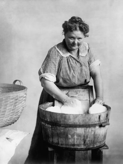 woman-doing-laundry-in-wooden-tub-and-metal-washboard-ca-1905_u-l-pihge20.jpg